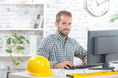 Young engineer working on his computer Stock Photo