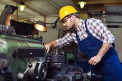 Engineer working at lathe royalty free stock photo
