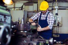 Engineer working at lathe royalty free stock photos