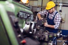 Engineer working at lathe stock image