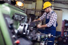 Engineer working at lathe royalty free stock photography