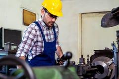 Engineer working at lathe royalty free stock image