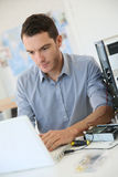 Young engineer working on recovery data. Engineer proceeding to data recovery from computer royalty free stock photo