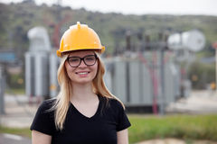 Young engineer with yellow helmet Stock Photos