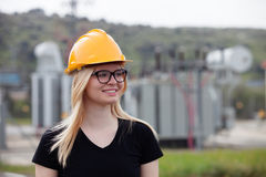 Young engineer with yellow helmet Royalty Free Stock Photography