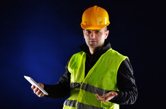 Young engineering with orange helmet Stock Image