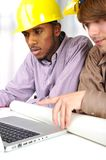 Young engineers, african and caucasian Royalty Free Stock Image