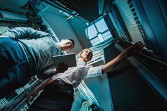 Young engineers businessmen in server room Royalty Free Stock Images