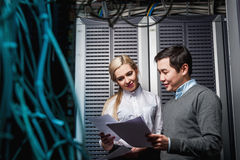 Young engineers businessmen in server room. Young engineers businessmen in network server room Stock Images