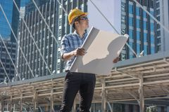 Young engineers looking at plans in the city. royalty free stock photos