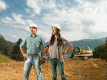 Young engineers supervising construction Royalty Free Stock Photo