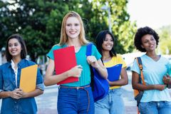 Young english female student with group of women royalty free stock images