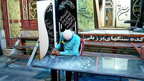 Young engraver makes inscription on the tombstone