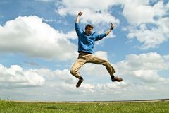 Young enthousiastic guy jumping up Stock Photo