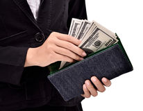 Young entrepreneur counting many dollars in purse Stock Photos