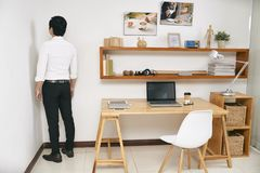 Businessman standing in office corner. Young entrepreneur disappointed in his work standing in room corner. No more possibility for the development concept stock images