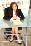 Young Entrepreneur at Office. Young Entrepreneur in Office Setting with Notepad Royalty Free Stock Photos