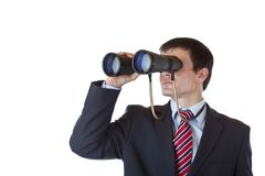 Young entrepreneur peers through binoculars. And search for career.Isolated on white background Royalty Free Stock Image