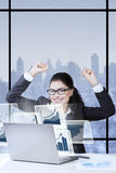 Young entrepreneur raising hand in the office Stock Photography