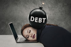 Young entrepreneur sleeps with debt bomb Royalty Free Stock Photos