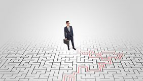 Young entrepreneur standing in a middle of a labyrinth royalty free stock photos