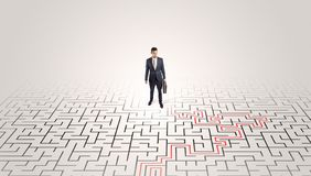 Young entrepreneur standing in a middle of a labyrinth royalty free stock image