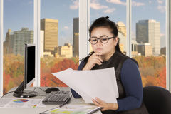Young entrepreneur thinking with papers Stock Photos