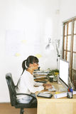 Young entrepreneur woman working on home office. Stock Photo