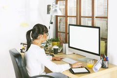 Young entrepreneur woman working on home office. Royalty Free Stock Images