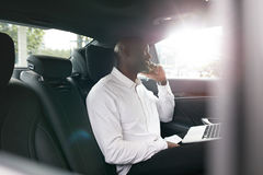 Young entrepreneur working during travelling to office Royalty Free Stock Photo
