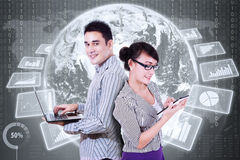 Young entrepreneurs with global financial statistics Stock Images