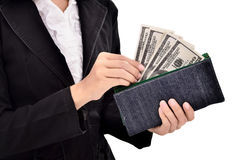 Young entrepreneurs insert a lot of dollars in the wallet Royalty Free Stock Images