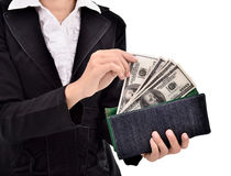 Young entrepreneurs take a lot of dollars in the wallet Royalty Free Stock Photos