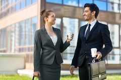 Young entrepreneurs. Two young entrepreneurs having talk while walking in the city Royalty Free Stock Photos