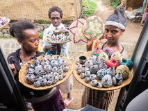 Young Ethiopian girl Ethiopian women selling crafts and souvenirs in Semien Mountains royalty free stock photography