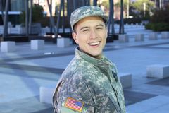 Young ethnic American soldier smiling royalty free stock photo