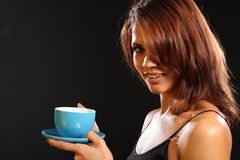 Young ethnic woman holding hot drink in blue cup Royalty Free Stock Photography