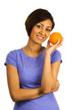 Young ethnic woman holds an orange. royalty free stock photos