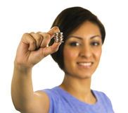Young ethnic woman holds a stack of coins. Royalty Free Stock Photos