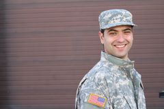 Young ethnically ambiguous American soldier and copy space on the right. Young ethnically ambiguous American soldier with copy space on the right stock photo