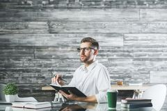 Young european businessman at workplace Royalty Free Stock Images