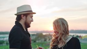 Young European couple dancing together and enjoying sunset at summer rooftop party stock video