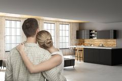 Young european couple in modern kitchen. Back view of young european couple in modern kitchen interior. Real estate, mortgage and dream concept. 3D Rendering stock photos