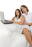 Young european couple surfing the web at home Royalty Free Stock Image