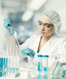 Young European female scientist or tech works in laboratory Royalty Free Stock Image