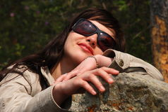 Young European girl in dark glasses. Royalty Free Stock Photos