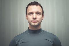 Young European man in gray sportswear royalty free stock photo