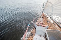 Young european man resting on yacht looking at sky royalty free stock image
