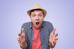 Man in summer hat with shocked expression, screaming royalty free stock photography