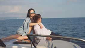 Caucasian couple in love relaxing on yacht bow, Travelling lifestyle concept